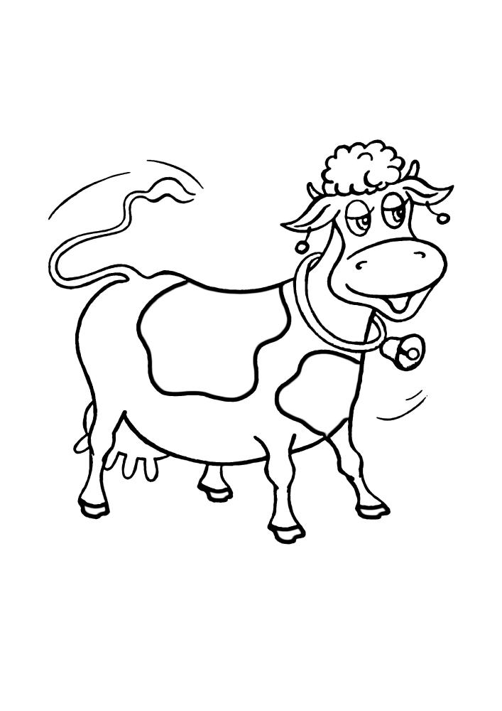 Корова машет хвостом и колокольчиком