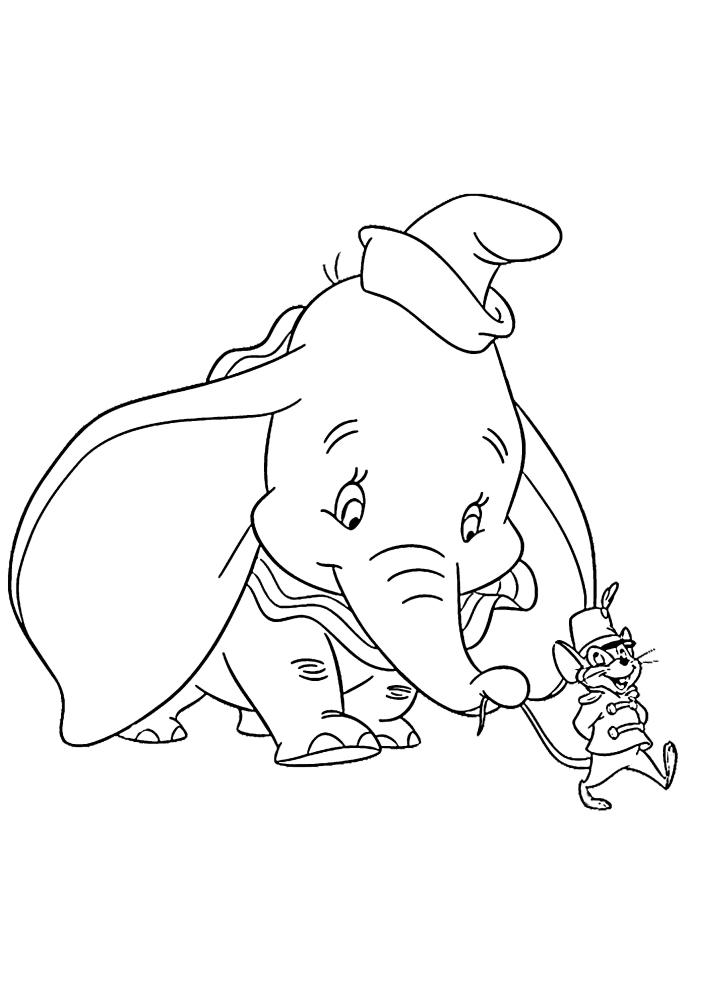 Тимоти ведёт слонёнка Дамбо на сцену.