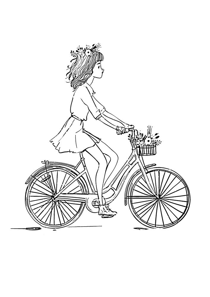 Милая девочка катается утром на велосипеде