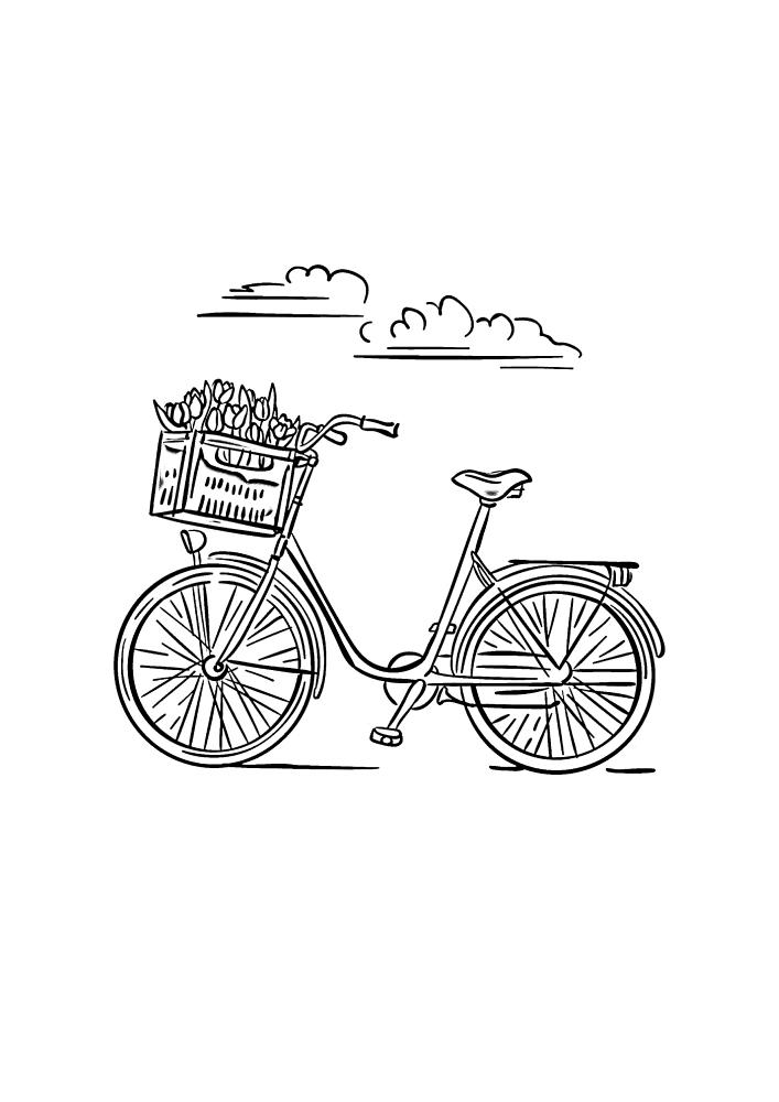 Велосипед с корзиной на фоне облаков
