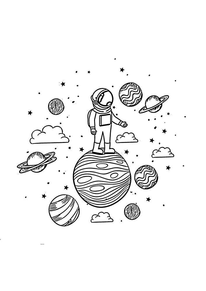 Космонавт стоит наверху планеты